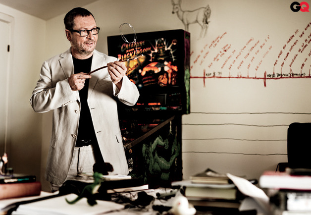 "Lars Von Trier in October 2011 issue of GQ gq: […] our favorite part of this completely fascinating profile—Trier is such uniquely sad, gifted, tormented artist, and perhaps our most unintentionally hilarious—is the moment when he agrees to watch the footage of his Cannes press conference that started all the fuss: ""Ayee-eeee…"" he says, physically wincing, as it begins. (His  ramblings are prompted by a question partly inquiring about the interest  he had expressed to a Danish film magazine about the Nazi aesthetic and  their achievements in the field of design.) ""Yeah, okay. I remember  that…"" He asks me to stop it for a moment, then continues.  ""Terrible…"" He sees the distressed look on Dunst's face, helpless to  stop the flow of disastrous words from the mouth of someone inches away  from her. ""I kind of didn't look at her,"" he remembers. ""But I had a  feeling that she was kind of reacting. But then I thought 'Ah, these  Americans, they're always so scared of everything, you know…' ""   ""Ah, these Americans, they're always so scared of everything, you know…"""