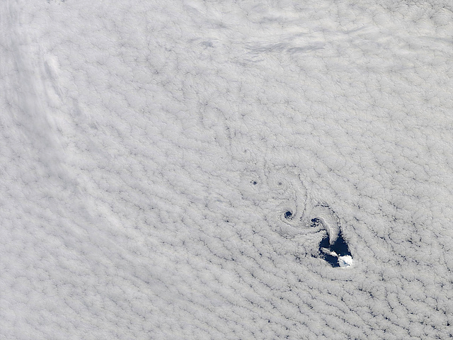 Cloud vortices, or Kármán vortex street, off Heard Island by NASA