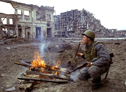 A Russian soldier lighting a cigarette during the First Chechen War. Grozny, Chechnya.