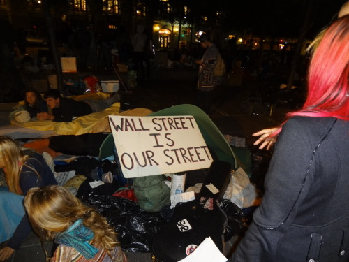 robotbearknight:  Occupy Wall Street. I was not even aware this was happening. Wasn't even on NPR in the morning. Solidarity folks. This is what it's going to take to get people moving. We're nothing but screwed, and it's not getting any better. The men responsible get off scot-free with all the cash they can steal. They are men, and they hide behind their corporate logos and stables of lawyers. Corporations are not people, and should never have been given our rights. We need to take them back. —- The 99% of everyone else who gets hosed by this system (that's you) are here on Tumblr. Support them. Several of the peaceful protesters were beaten and arrested this morning. You can donate to the cause by paying for chow. —- (Click through for the organization's website)