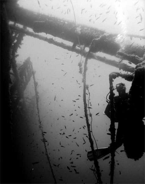 diver behind the broken ship mast. at 30m. mirna-m ,turgutreis-bodrum.