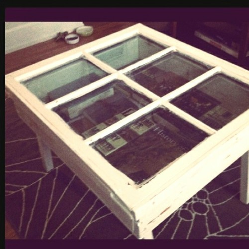 vintage window made into a coffee table…. brilliant.