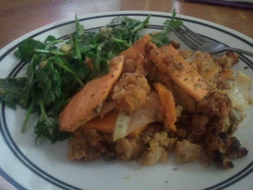 Sweet potato, sausage and cornbread stuffing and an arugula salad with apple cider reduction and poached egg.