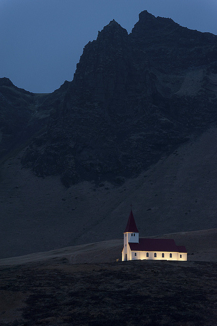 Church in Vik, Iceland by BillKristiansen on Flickr.Via Flickr: Vik (or Vík í Mýrdal) is a small fishing town in Southern Iceland with a small population of about 300 people.  This church sits above the rest of the town on a hilltop.  The church is considered a safe spot in the event the nearby volcano Kitla erupts, melting the Mýrdalsjökull glacier that threatens to wash away the town.