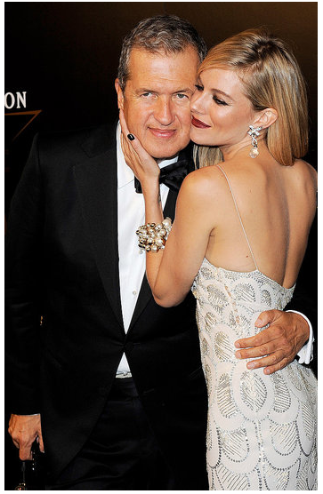 bellalookbook:  Sienna Miller with Mario Testino at the Moet & Chandon Etoile Awards in his honor.