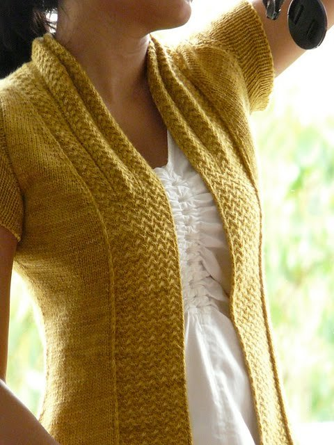 This is such a clever modification to turn a scarf into a cardigan! Love love love it!  Shifting Sands Scarf by Grumperina on Ravelry
