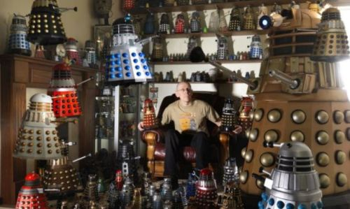 "classicdoctorwho:  Doncaster's Rob Hull and some of his 571 Dalek models (his collection has put him into the Guinness Book of Records). Mr Hull's wife says of the collection: ""I am not that keen on them. I'd rather they were not there, I'd rather have them in the garage."" To Mr Hull's wife, on behalf of all Whovians, I say ""Habituate! Habituate!""."