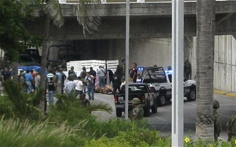 "Drug Traffickers Dumped 35 Bodies Beneath Overpass During Rush Hour (WIDK) Posted to WIDK by Emily Moore MEXICO CITY (Olga R. Rodriguez, AP) — Suspected drug traffickers drove two trucks to a main avenue in a Mexican Gulf coast city and dumped 35 bodies beneath an overpass during rush hour as gunmen stood guard and pointed their weapons at frightened drivers.  Horrified motorists trapped at the scene grabbed cell phones and sent Twitter messages warning others to avoid the area on a thoroughfare near the biggest shopping mall in Boca del Rio. The gruesome scene Tuesday was a sharp escalation in drug violence in Veracruz state, which sits on an important route for drugs and Central American migrants heading north. The Zetas drug cartel has been battling other gangs for control of the state. Veracruz state Attorney General Reynaldo Escobar Perez said the bodies were left piled in two trucks and on the ground under an overpass near the mall and a statue of the Voladores de Papantla, ritual dancers from Veracruz state. Police had identified seven of the victims so far and all had criminal records for murder, drug dealing, kidnapping and extortion and were linked to organized crime, Escobar said. He didn't say to what group the victims belonged. Motorists posted warnings on Twitter that masked gunmen in military uniforms were blocking Manuel Avila Camacho Boulevard and pointing their guns at civilians. ""They don't seem to be soldiers or police,"" one tweet read. Another said, ""Don't go through that area, there is danger."" Escobar said police were reviewing surveillance video recorded in the area. Local media said that 12 of the victims were women and that some of the dead men had been among prisoners who escaped from three Veracruz prisons on Monday, but Escobar said he couldn't confirm that. At least 32 inmates got away from the three Veracruz prisons. Police recaptured 14 of them. Earlier Tuesday, the Mexican army announced it had captured a key figure in the cult-like Knights Templar drug cartel that is sowing violence in western Mexico. Saul Solis Solis, 49, a former police chief and one-time congressional candidate, was captured without incident Monday in the cartel's home state of Michoacan, Brig. Gen. Edgar Luis Villegas said during a presentation of Solis to the media. Solis is considered one of the principal lieutenants in the Knights Templar, which split late last year from La Familia, a pseudo-religious drug gang known as a major trafficker of methamphetamine. Drug violence has claimed more than 35,000 lives across Mexico since 2006, according to government figures. Others put the number at more than 40,000. In northern Mexico, the army announced the detention of two more suspects in a casino fire that killed 52 people last month in the northern city of Monterrey. The two men captured at a bar in Monterrey late Monday confessed to being members of the Zetas drug cartel and participating in the attack, federal prosecutors said. Separately in Nuevo Leon, Mexican marines captured 19 alleged members of the Zetas drug cartel at a ranch that was being used as a training camp in the town of Colombia, the military announced. A navy statement said that seven minors were among those detained and that marines seized four rifles, a pistol, and several military uniforms and boots. Original Article"