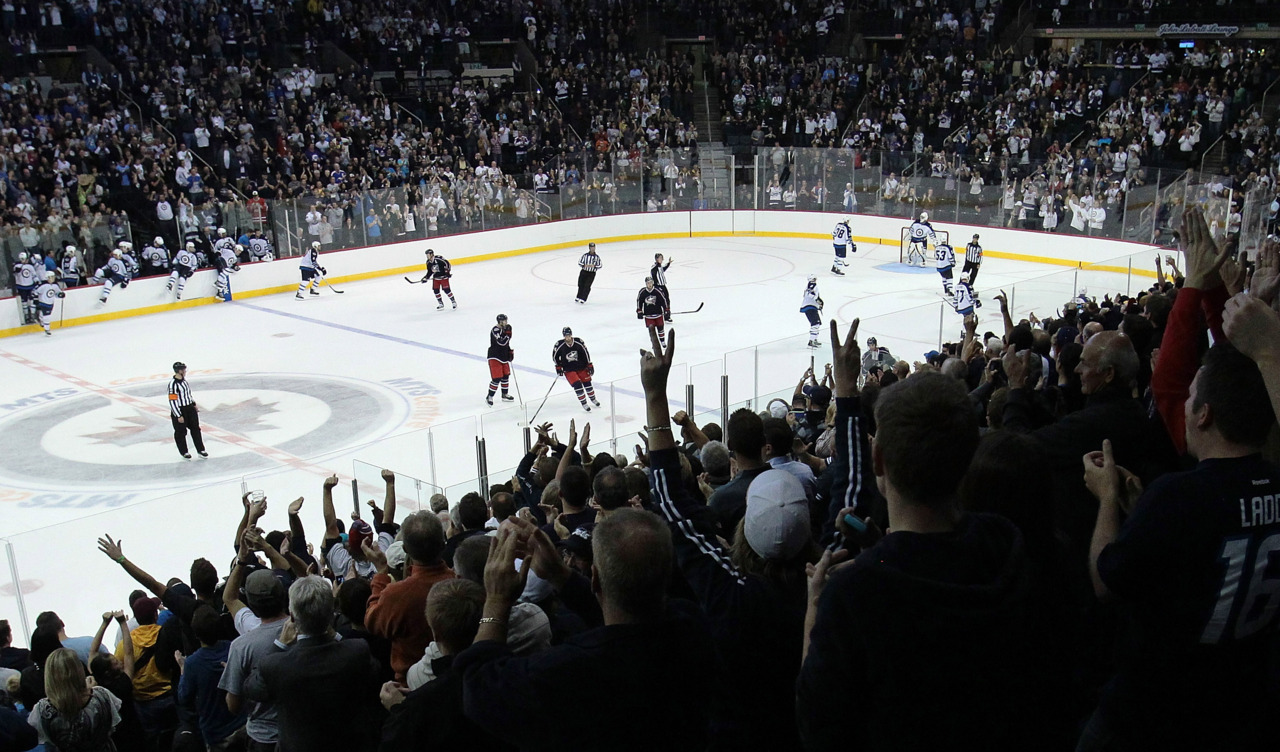 nationalpostsports:  The Winnipeg Jets played their first home game, albeit an exhibition one, to a full house on Tuesday. Marianne Helm/Getty Images
