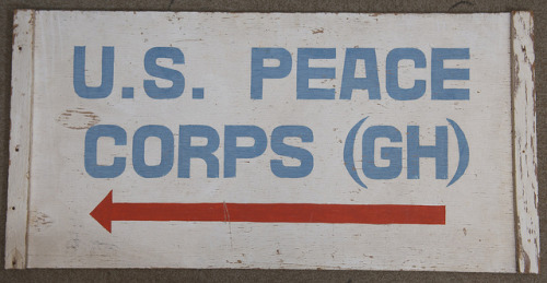 The sign that hung at the original Peace Corps office in Ghana, the first country to host Peace Corps Volunteers.