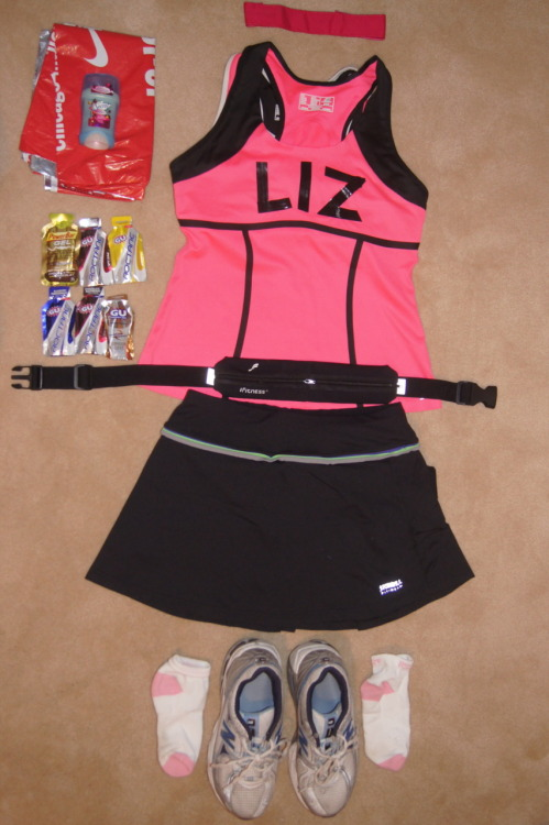 Berlin Marathon outfit head to toe:  Head BandSports BraPink TopGel BeltRunning skirtSpandex sexy shorts (to avoid the chub-rub)SocksShoesGelsMetal warm thingy (save from the Chicago marathon to keep me warm pre-run)Garmin watch (not pictured)Bodyglide (not pictured)  Countdown: 4 days!!!!!!!!!!!!!!!!!!!!!!!!!!!!!!!!!!!!!!!!!!. (<— There are 42.2 exclamations. Believe it)