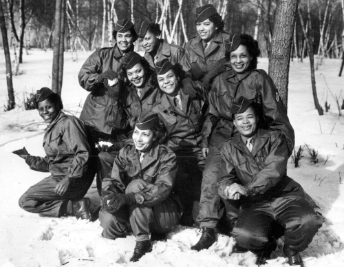 Members of the Women's Army Corps (WAC) pose at  Camp Shanks, New York, before leaving from New York Port of Embarkation  on Feb. 2, 1945. The women are with the first contingent of Black  American WACs to go overseas for the war effort From left to right are,  kneeling: Pvt. Rose Stone; Pvt. Virginia Blake; and Pfc. Marie B.  Gillisspie. Second row: Pvt. Genevieve Marshall; T/5 Fanny L. Talbert;  and Cpl. Callie K. Smith. Third row: Pvt. Gladys Schuster Carter; T/4  Evelyn C. Martin; and Pfc. Theodora Palmer. (AP Photo)