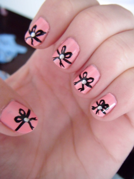 Beautylish Beauty Kalie B.'s pretty ribbon nails are a great reminder that it's Breast Cancer Awareness month! Check out these pretty pink polishes - each purchase benefits the cause!