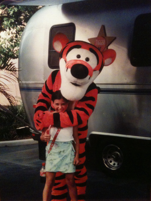 i was 9. hated disney. loved tigger. also, it appears I am sporting le strap o' cola. Cool