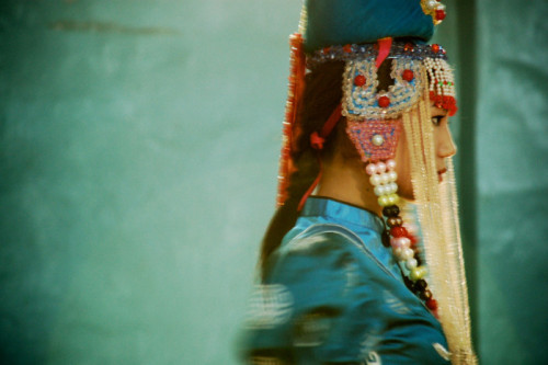 A Mongolian woman, wearing a traditional Mongolian headdress, participates in the Darkhan Nursing College's beauty pageant.  - Peace Corps Education Volunteer Chris De Bruyn
