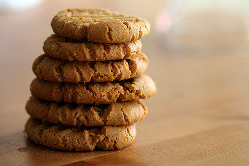 Flourless Peanut Butter Cookies makes about two dozen cookies 1 cup all-natural chunky or smooth peanut butter 1 cup sugar (1/2 cup brown sugar and 1/2 cup granulated sugar) 1 egg 1 teaspoon baking soda Preheat oven to 350 degrees F.  Grease a baking sheet with butter and set aside.  In a mixer combine peanut butter and sugars until well combined, about 2 minutes.  Add egg and baking soda and mix for another 2 minutes.  Roll into walnut sized balls and create a cris-cross pattern with a fork.  If you'd like, add a few chocolate pieces to the top of the cookies.  Bake for 10 minutes, until lightly browned.  Cool on a baking sheet for two minutes, then transfer to… your mouth.
