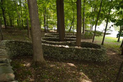 Andy Goldsworthy's wall, gracefully arching around trees at  Storm King