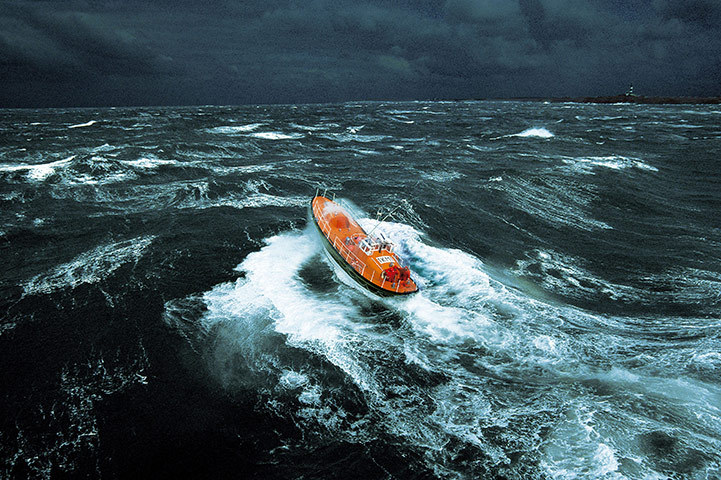 mabelmoments:  A lifeboat negotiates stormy conditions off Ile d'Ouessant in Brittany, France. Photograph: Phillip & Guillaume Plisson /Rex Features
