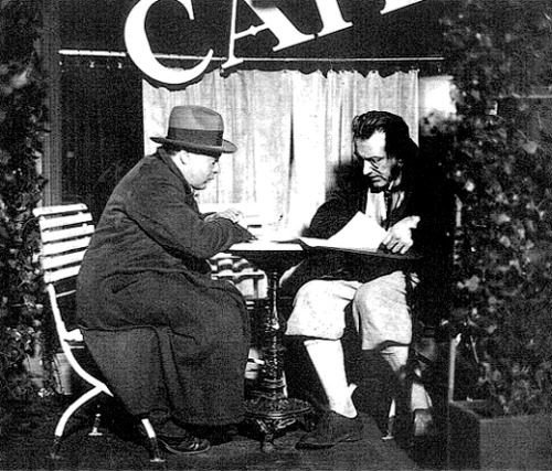 criterioncorner:  Peter Lorre and Fritz Lang comparing notes on the set of M Peter Lorre's iconic child-killer Hans Beckert seems like one of those movie villains so fundamentally a part of the cinema that to see him between takes is something of a rare and hugely jarring shock to the system. and yet here he is, in full costume, chatting with Fritz Lang about his motivation, or the latest fashions in knee-high socks… but probably his motivation. i barely recognize him in this blanket lighting. great photo, need more BTS stuff from this, one of of my favorite films. via (@ericvespe's Behind the Scenes Pic column at AICN).