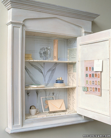 Decorating the inside of your cabinets gives the room a nice touch!