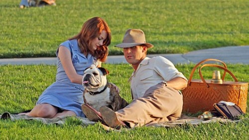 First Look at Ryan Gosling and Emma Stone in 'Gangster Squad' 'Crazy, Stupid Love' stars Emma Stone and Ryan Gosling reunite (and rock the retro chic) on the set of their new movie 'Gangster Squad.' The 1940s Los Angeles crime drama finds Gosling and Josh Brolin as cops gunning for mobster Mickey Cohen (Sean Penn); Stone is the woman caught in the crossfire. More pics of Gosling and Stone enjoying a day in the park with their bulldog ahead.