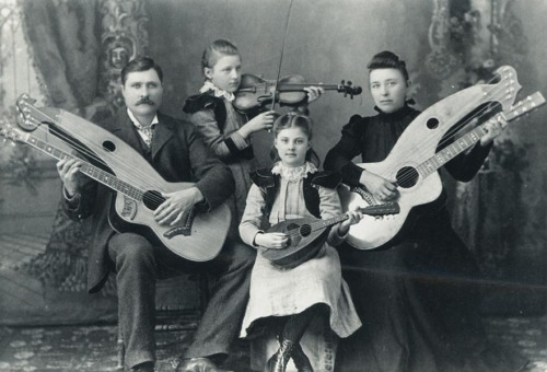 "moonjunk:  The Knutsen family with two harp guitars by     Chris J. Knutsen (whose real name was   Johan Christian Kammen) in 1897.  ""Let's get this party started"""