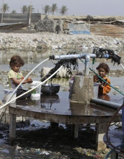 انجازات الحكومة العراقية !! : #Iraq i girls fill containers of water from a public water hose on open ground in Baghdad's eastern suburb of Fadaliayah, Iraq, Thursday, Sept. 22, 2011. The neighborhood has no municipal water supply. (AP Photo/Karim Kadim)