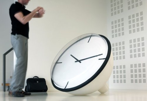 trop belle! rozanes:  ReCraft Your Clock: Van Esch OCLOCK It may sound rather odd coming from the mouth of a designer. Yet architect Anthony Duffeleer regards the shape of the Oclock he has designed incidental. Its shape is a consequence of the production process, he explains, which in this case is rotation casting. This is a process in which plastic powder goes in a mould, which is then placed in an oven and rotated. The plastic adheres to the wall and in this way takes on its final shape. 'Design is an unbelievably pretentious word,' says the architect, who, together with Freia Rombouts, is the driving force behind the Antwerp firm Frap. 'A designer is really a process supervisor.' It is the quest for the right production method that appeals to Duffeleer. In the case of the Oclock this leads to an exciting, in some ways organic shape. A further benefit of the production process is that despite its generous dimensions - the dial is around 120 centimetres in diameter - the clock is nonetheless light in weight. Duffeleer is also breaking with the standard image of a clock. 'This design is individual, it has pretension. It is an object that has an almost obtrusive presence in the room. And that's the idea. Even if the room is otherwise empty, with this clock it is nonetheless full.'—————————————————————————————————Displayed on Recraft | Facebook | Twitter—————————————————————————————————