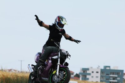 Lav Lavinia on her purple stunt bike