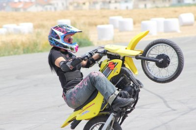 Lav Lavinia on a cute little yellow Suzuki dirt bike