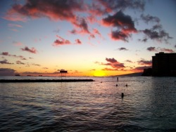 Watching the sunset at Waikiki beach feels wonderfully surreal submitted by: richgail, thanks!