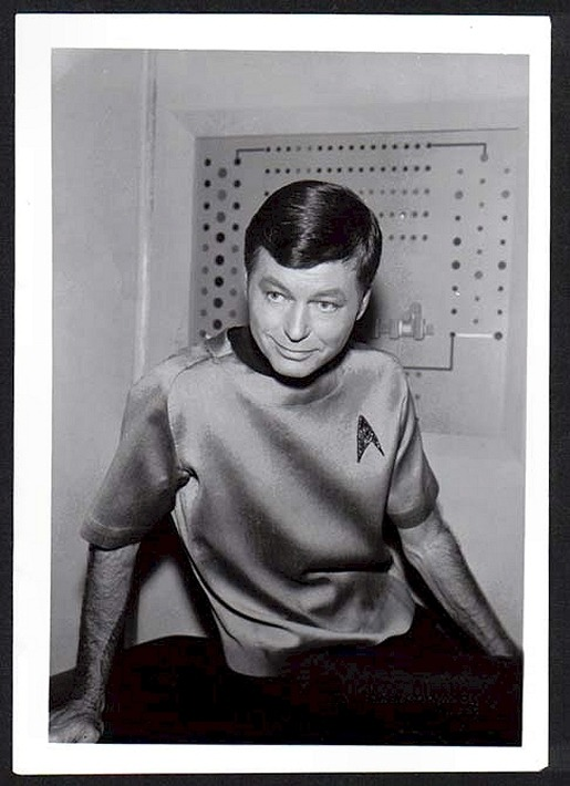 Just an awesome publicity shot, candid style, of DeForest Kelley as Dr. McCoy on Star Trek. I liked this photo so much that when I went to make a McCoy signature for a BBs I run, I went to the trouble of colorizing it by hand for such.