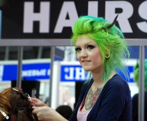 Three things: I'm not much for colored hair but wow, I love the green! Her blonde eyebrows compliment the green hair really well. WTF - IS THAT A HAIR-HORN???