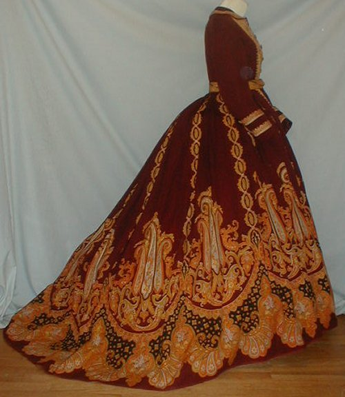 Formal dress worn to a wedding, ca late 1860's One day left to bid!  Click here. Watch out though.  It appears to be haunted.  If you look closely, there's a white circle near the waist.  This is obviously an orb. lol No, but seriously I am so jealous of you if you have the money to buy this.  If any of you do win it, post some detail shots of that embroidery.