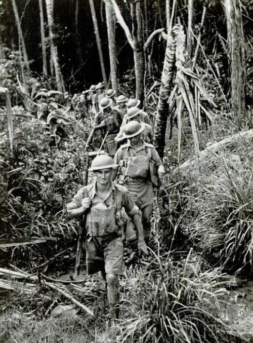 Dense jungles, like this one in which Australians are marching single file, cover about three-quarters of Malaya and lie between the Japanese and Singapore. The jungle is pitch black in spots and dotted with pill-boxes. The few roads of Malaya are minded as well, acting as a natural defense against the invading enemy forces (LIFE, 22 Dec 1941)