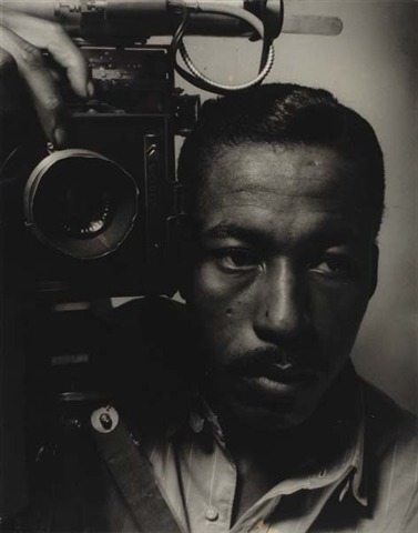 "Self-Portrait, Gordon Parks. Via artnet.  Earlier this month, I attended a talk related to a project called CHROMA, which is intended to foster ""pluralism within the field of photography and lens-based media by supporting the work of emerging artists of African, Latino, Native American, Middle Eastern, North African, Asian, and Pacific Island heritage.""  The conversation tended strongly toward academic/fine arts inside baseball. Not surprising, considering the venue and audience — but not really our beat. However, something that came up in the question and answer period struck me as interesting and within the 1/125 remit:  One of the audience members was worried about changes related to ephemera (like written correspondence) and the impact of those changes on biography in the arts. What, if anything, will take the place of letters in providing biographical detail about the artists of our time? Are emails and tweets likely to be preserved in a way that will be usable for future biographers?  I expected the ensuing discussion to be either a stultifying technical speculation on digital archiving, or else a dirge for old media. But the response from Deborah Willis went in a different direction.  She talked about the upcoming Centennial of Gordon Parks's birth, and about researching an article she was asked to write about him. She said that Parks wrote five memoirs — which seems like a rather excessive number for anyone. But Willis pointed out that while Parks wrote extensively about himself, few other writers have done so. It seems biographical work on him is scarce, and Parks is missing from a number of recent works which survey documentary photography and photojournalism. (Which seems crazy.)  Willis said, ""If Gordon hadn't written his stories, no one would know he existed,"" and so, ""My suggestion to you as an artist is: start writing your story."""