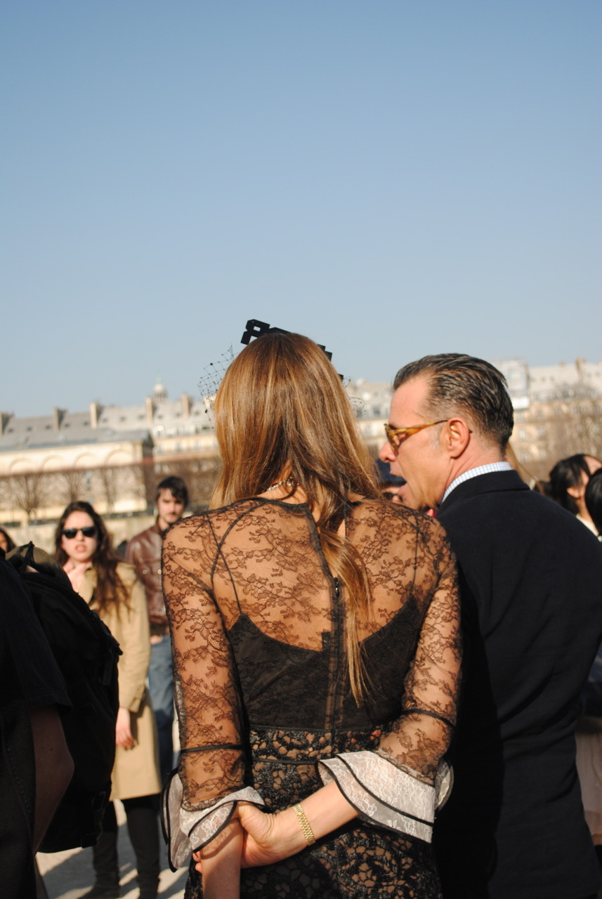 Anna Dello Russo, Paris Every time a celebrity, or in this case a fashion celebrity, appears out of thin air, the shadows, or descends from heaven, whichever you prefer, a slight upheaval will take place. In these instances you must be quick. If you are not willing to run, push, and get down on the ground, don't place your bets on getting a great photo…from the front. I am not a professional photographer, but I did do all of the above. Though with this photo I stayed behind. She looks a bit innocent and shy with that hand behind her back.