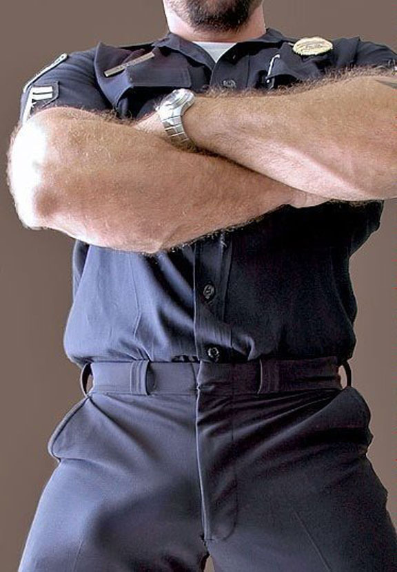cutmeat:  supervillainl:  Strong arm of the law. Strong bulge of the law.  It's a misdemeanor to be uncircumcised.