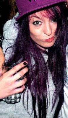 "Oh, by the way, my hair is purple again. I loved the red but it had faded so badly and I was starting to get sick of the ""are you trying to look like Rihanna?"" comments every time I went out! Plus walking through the university on Fresher's week I saw far too many nervous and squeaky girls with the same hair colour wandering around looking lost. Plus I happened to have purple dye left over from last time it was this colour. I'll post a better photo when I have a moment, I've got so much to be getting on with at the moment - it's really quite daunting! Credit for this photograph goes to the Small Time Krooks photographer that was shooting at Voodoo Lounge on Wednesday (it's a crop from a larger image, sorry about the quality and size but we all know what Facebook compression is like!)"