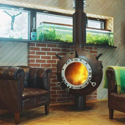 sketchygrrl:  Steampunk woodstove? Hells, yeah!  I gotta play the Lottery so's I can hit me one of these, and a big ol' place to put i! Very cool!