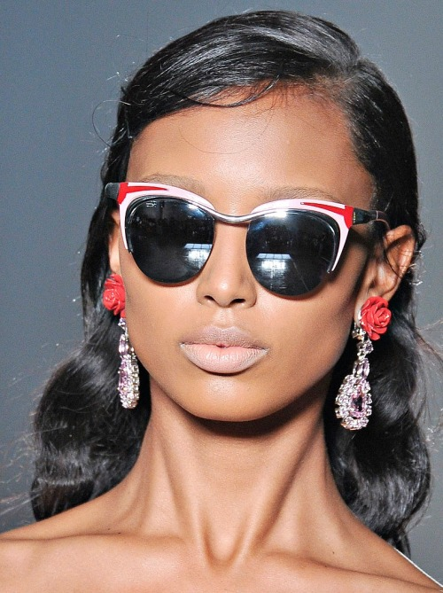 Earrings. Sunnies. Lipstick.  vogue:  DETAIL: Prada Spring 2012