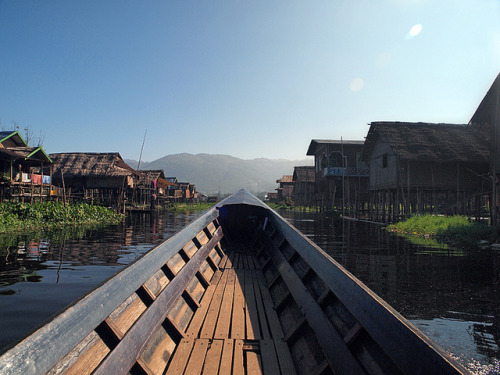 Maing Thauk Village by Julian Kaesler on Flickr.  The people of Inle Lake (called Intha), some 70,000 of them, live in numerous small villages along the lake's shores, and on the lake itself. Most are devout Buddhists, and live in simple houses of wood and woven bamboo on stilts.