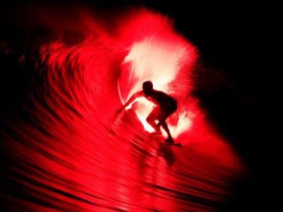 "Extreme Photo of the Week: Surfing the Mentawai Islands, Indonesia ""I was just hugging the face of the wave waiting for it to barrel,"" says pro surfer Bruce Irons, who was willing to give his pal Sam McIntosh's ""flare surfing"" idea a try off Indonesia's Mentawai Islands. First the crew tested the idea in the very early morning. ""I really didn't know if it was going to work, or if the flare would just burn right through my board,"" notes Irons. Once they felt confident in the mechanics, they set out at night. ""We took a Jet Ski out to where the waves were meant to break,"" says Irons. ""I couldn't see more than 20 feet in front of the ski."" When the wave approached, a friend pulled the flare chord, and Irons jumped. A world-class surfer like Irons makes it look easy, but do not try this at home. ""Considering my buddy Peter almost lost his eyesight pulling the flare cord on this night, I would say stick with what you are taught as a kid: Don't play with fire."" Getting the ShotHaving recently photographed the Nike ""Just Do It"" night ad campaign, photographer Jason Kenworthy was familiar with photographing surfers at night. ""It was dark and there was only one chance to get it … no do-overs,"" recalls Kenworthy. To make this photograph, Kenworthy was located on a skiff looking directly into the barrel. ""Focusing was a challenge due to the darkness. And with the dropping light, you are constantly guessing on your exposures—and then second-guessing,"" says Kenworthy, who used a Canon Mark IV. ""The 2.8 and instant stabilization worked great, and the high ISO settings came in handy."" Photograph by Jason Kenworthy, A-Frame"
