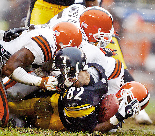 Pittsburgh's Antwaan Randle El has his head turned around by Cleveland's Chris Akins during a 2003 Steelers-Browns game. (Bob Rosato/SI) GALLERY: Did You See That?