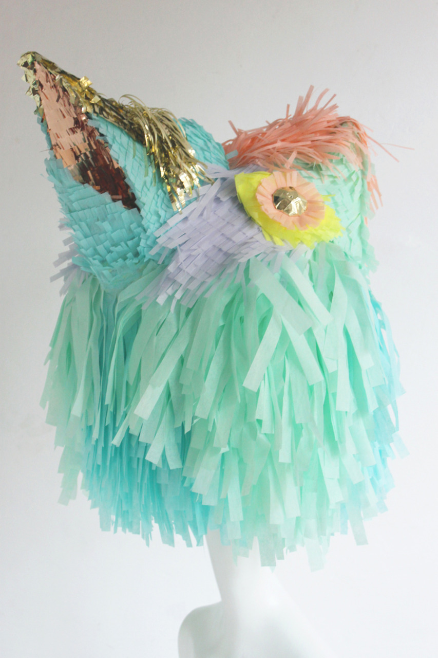 Custom fringed exotic bird mannequin head by Confetti System at Opening Ceremony New York. Photo by confettisystem