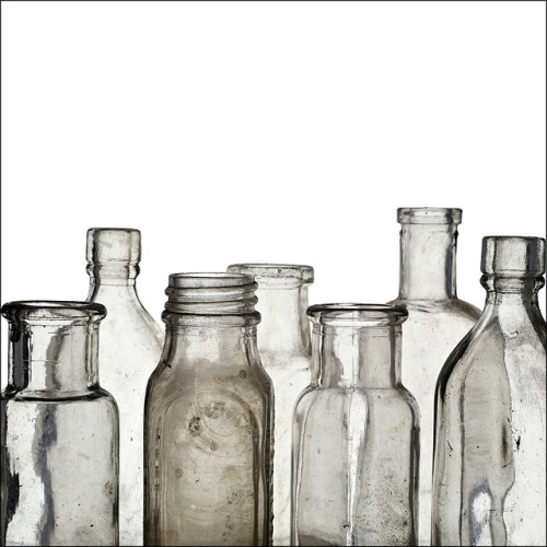 elemenop:  antique glass bottles by friendlydrag0n on Flickr.