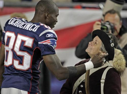 globephoto:The Boston Globe staff photos of the week, Sept. 23, 2011Patriots wide receiver Chad Ochocinco shared a moment with a member of  the