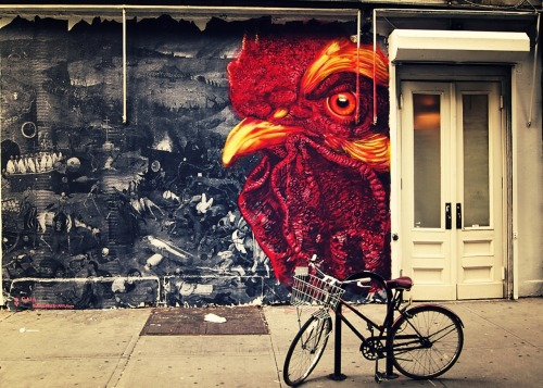 "nythroughthelens:  Street art. Soho, New York City Through each and every scattered urban landscape every sidewalk dream unfolds periphally as daily adventurers traverse the city full of promise and silent giddy trepidation. It's in the quiet still moments marked by emptiness, vast loneliness and encroaching solitude that these peripheral dreamscapes come into focus. These moments, suspended in time, marinate in the severity of their potential to eventually etch themselves into the eternity of the mind. The rest of time moves with the rapid ebb and flow of life like bits and pieces of paint on a wall chipping and peeling off, finally scattering like a discarded lover's flower petals in the wind. —- —- Buy ""Watching You"" Prints and Posters here, View my store, email me, or ask for help."