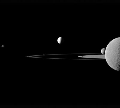 dendroica:  A quintet of Saturn's moons come together in the Cassini spacecraft's field of view. Janus (179 km, or 111 miles across) is on the far left. Pandora (81 km, or 50 miles across) orbits between the A ring and the thin F ring near the middle of the image. Brightly reflective Enceladus (504 km, or 313 miles across) appears above the centre of the image. Saturn's second largest moon, Rhea (1,528 km, or 949 miles across), is bisected by the right edge of the image. The smaller moon Mimas (396 km, or 246 miles across) can be seen beyond Rhea also on the right side of the image. Picture: REUTERS/NASA/JPL-Caltech/Space Science Institute (via Pictures of the day: 23 September 2011 - Telegraph)