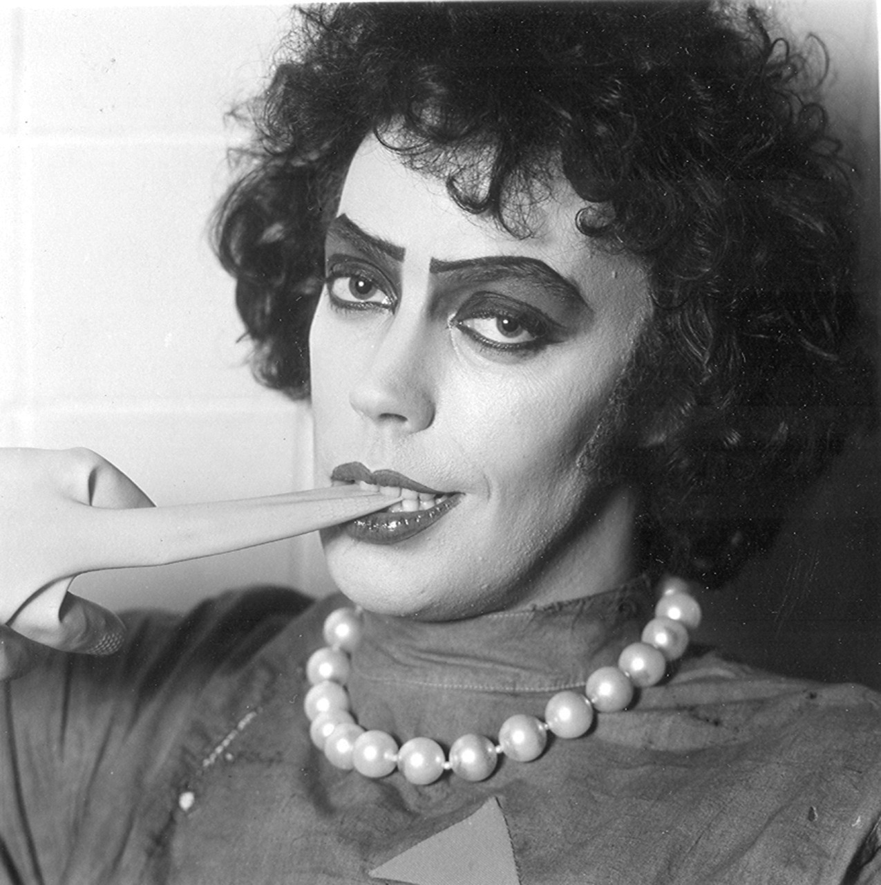 suicideblonde:  Tim Curry as Dr. Frank-N-Furter photographed by Mick Rock